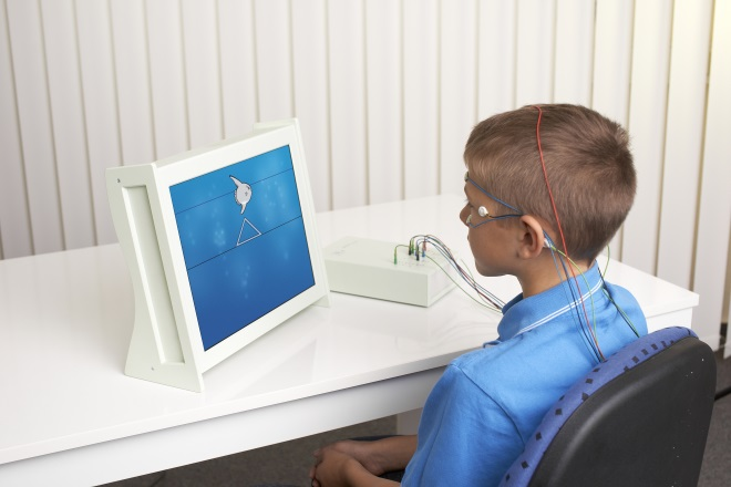 Boy training brain activity with Neurofeedback